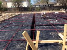 Slab on ground foundation with post tension cables